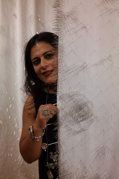 "Photo courtesy of Divya Annamraju - SARIKA GOULATIA WITH SOME OF HER ARTWORK FROM ""DRESSED WITH D.R.E.S.S"""