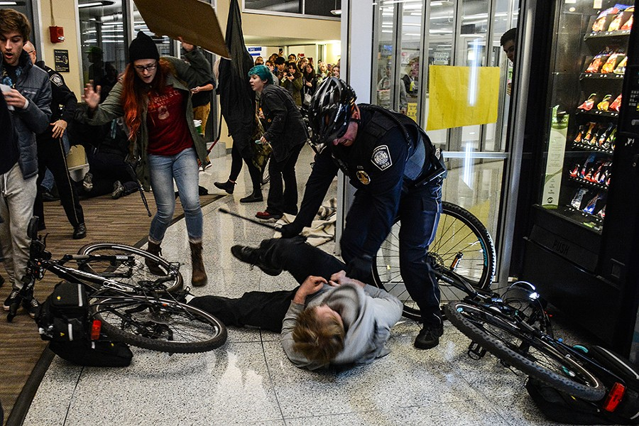 Protesters clash with police on the University of Pittsburgh campus. - CP PHOTO BY STEPHEN CARUSO