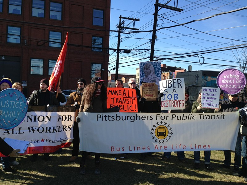 Public-transit and labor activists protesting Uber in February. - CP PHOTO BY RYAN DETO