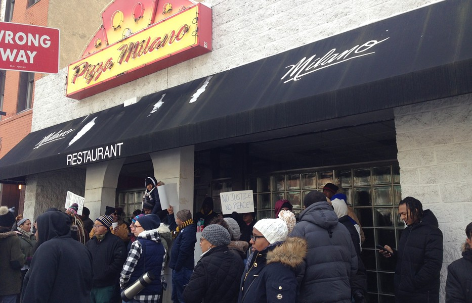 Protesters outside Pizza Milano in Uptown on Jan. 15 - CP PHOTO BY RYAN DETO