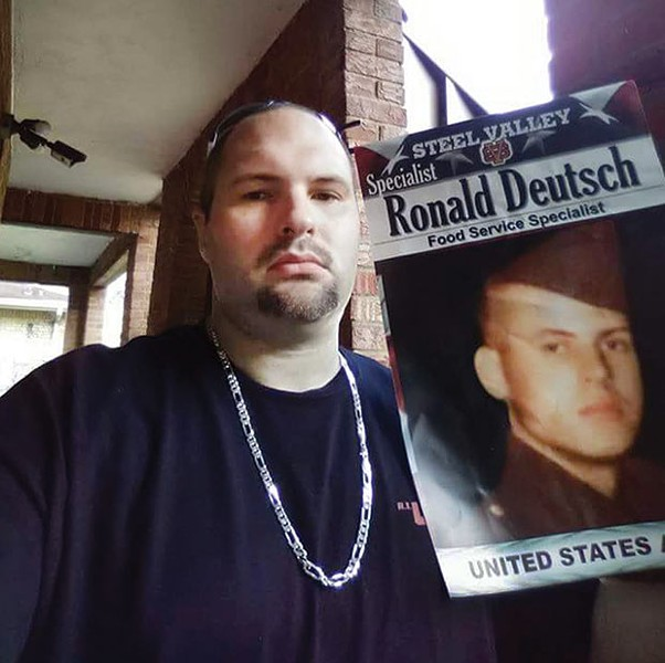 Jason Deutsch holds up a photo of his late father. - PHOTO COURTESY OF JASON DEUTSCH