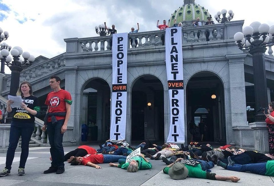 "Protesters in Harrisburg staging a ""die-in"" to protest for universal health care - PHOTO COURTESY BEN FIORILLO"