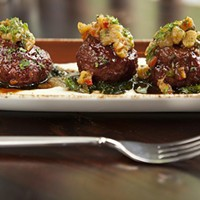 Sienna Mercato Lamb meatballs with braised escarole Photo by Heather Mull