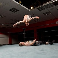 Code Red Wrestling Dan Sandwich performs a moonsault on J-Ru. Photo by Theo Schwarz