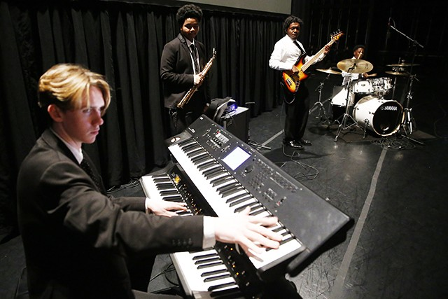 Members of Funky Fly Project sound check at the August Wilson Center on Sat., Nov. 10. - CP PHOTO: JARED WICKERHAM