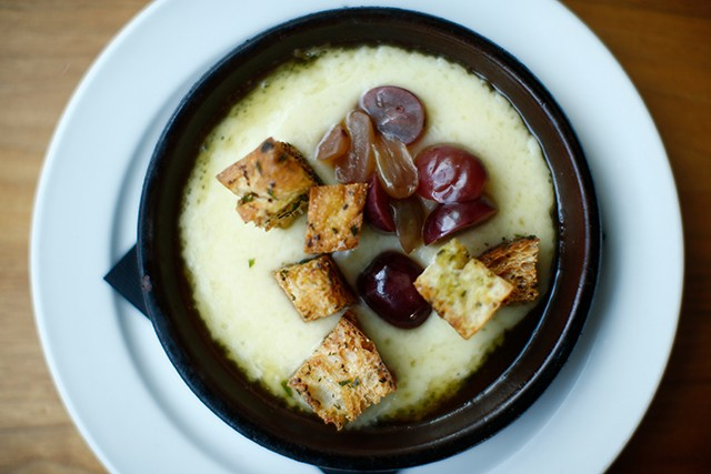 Melted gruyere cheese with croutons and pickled grapes - CP PHOTO: JARED WICKERHAM