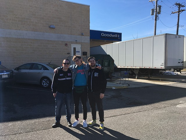 Josh Larkin, Toddy Tondera, and Ryan Thompson outside Goodwill Outlet Center. - CP PHOTO: AMANDA WALTZ
