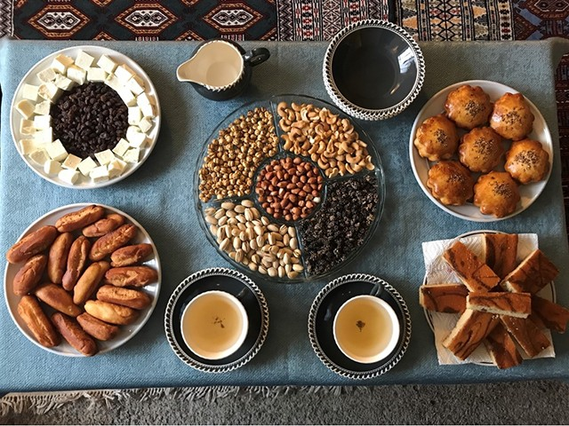 A table of Afghan tea and snacks - MOLLY RICE