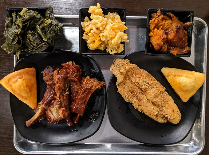 Top, left to right: collard greens, mac n' cheese, and yams. Bottom: entrees of ribs and fried catfish, with cornbread on the side. - CP PHOTO: MAGGIE WEAVER