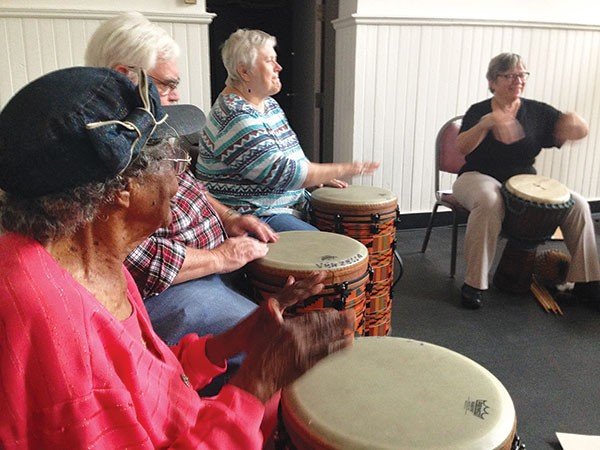 Market House seniors join a drum circle at the center. - JENNIFER SZWEDA JORDAN