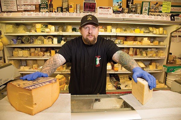 Penn Mac's cheesemonger Richard Derzic Jr. - PHOTO BY THEO SCHWARZ