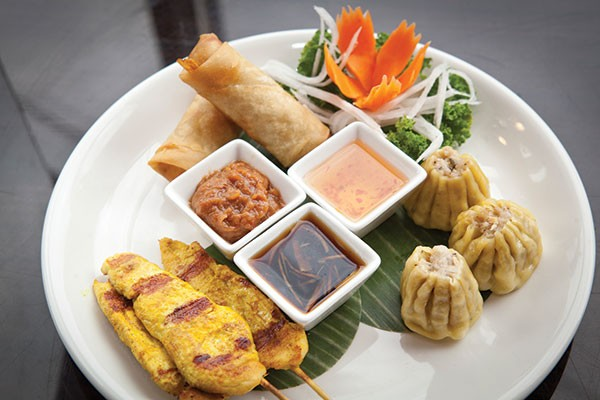 Appetizer sampler with steamed dumplings, chicken satay and shrimp spring rolls - PHOTO BY HEATHER MULL