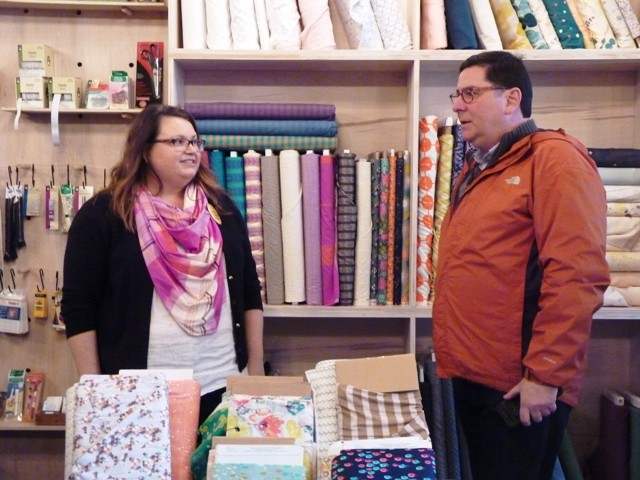 Michelle Lancet, co-owner of the fabric store Spool, in Allentown, welcomes Pittsburgh Mayor Bill Peduto for a visit on Small Business Saturday. - PHOTO BY ASHLEY MURRAY