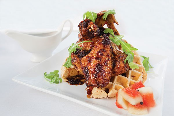 Spicy wings and waffle with Korean chili sauce and pickled watermelon - PHOTO BY HEATHER MULL