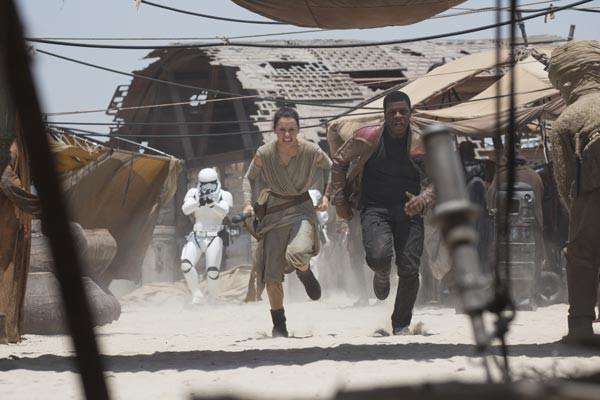 On the run: Rey (Daisy Ridley) and Finn (John Boyega)