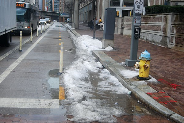 Unplowed snow on the Penn Avenue bike lane remained on Jan. 26. - PHOTO BY RYAN DETO