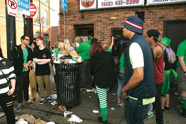Revelers on East Carson Street on Saturday after the St. Patrick's Day Parade