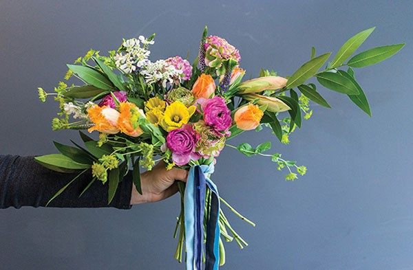 A colorful bridal bouquet created by The Farmer's Daughter Flowers