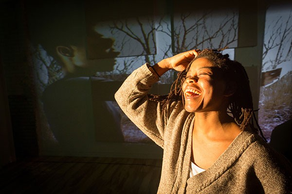 "Corinne Spencer with the video component of her work ""Hunger"" - PHOTO BY RENEE ROSENSTEEL"
