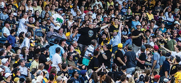 Fans making a play for a foul ball at PNC Park in June