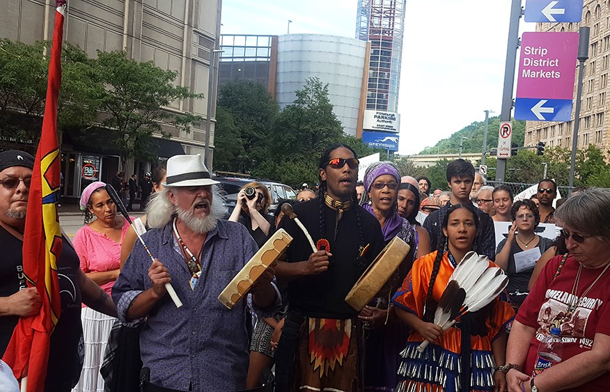 A group closed out today's protest in song - PHOTO BY REBECCA ADDISON