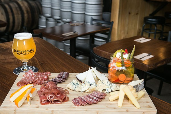 Insurrection AleWorks beer paired with a cheese and charcuterie board