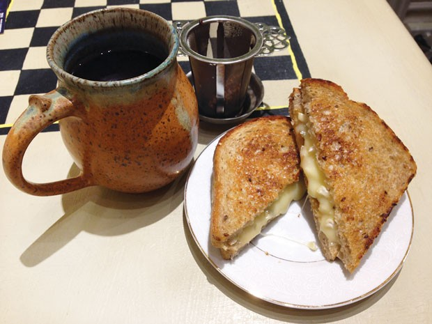 Mug of plum-cinnamon tea and a grilled-cheese sandwich, with brie and pepper jam - CP PHOTO BY RYAN DETO