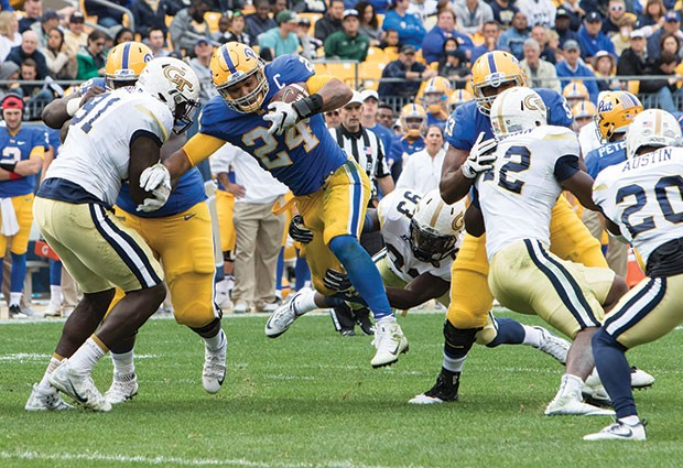 Pitt running back, James Conner, moves up field against Georgia Tech Oct. 8 at Heinz Field. - CP PHOTO BY LUKE THOR TRAVIS