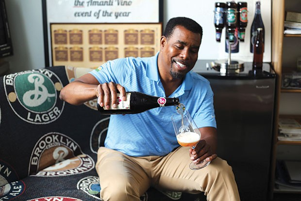 Garrett Oliver, brewmaster at Brooklyn Brewery, pours a beer during an interview with Hop Culture. - CP PHOTO COURTESY OF HOP CULTURE