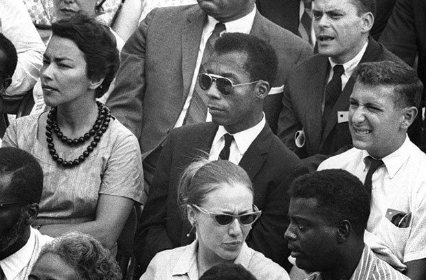 Alone in a crowd: James Baldwin (center)