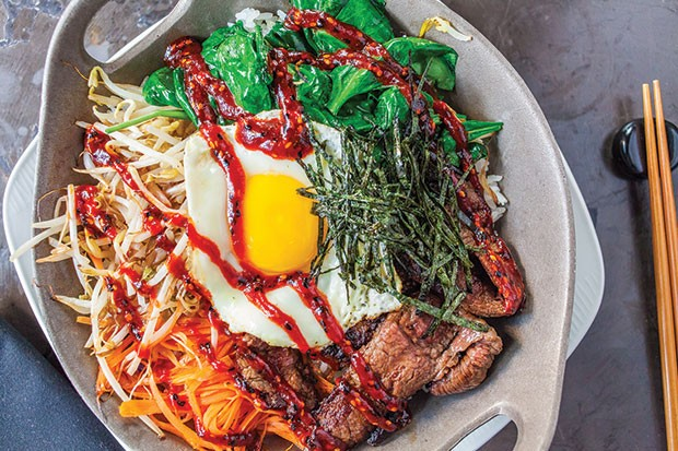 Bi bim bap with wagyu beef, carrots, bean sprouts, spinach, dippy egg, Korean BBQ sauce and rice