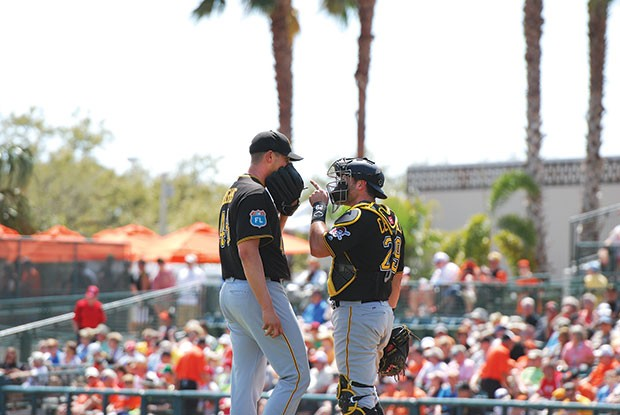 Pirates catcher Francisco Cervelli has a serious chat with pitcher Jared Hughes during a spring-training game last year against Baltimore.