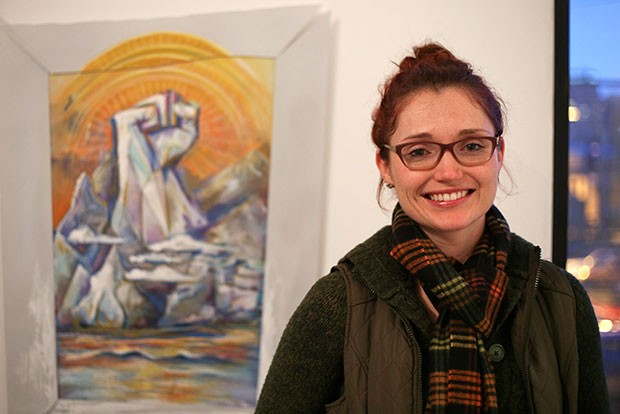 Randi Stewart with her mixed-media painting, part of AIR's Active Voice show - CP PHOTO BY JOHN HAMILTON