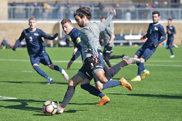 Pittsburgh Riverhound defender Jack Thompson launches a long pass. - CP PHOTO BY JOHN HAMILTON