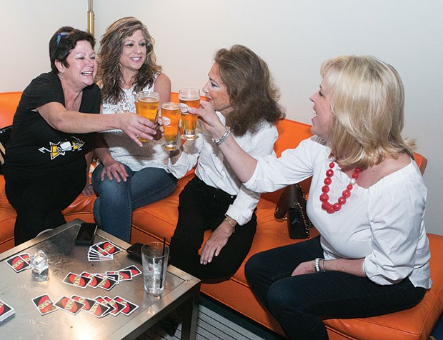 Patrons make a toast during Couch Brewery's grand opening on Sat., April 29.