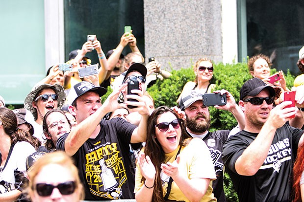 Pens fans cheering on the team during 2016's Stanley Cup victory parade - CP PHOTO BY LUKE THOR TRAVIS