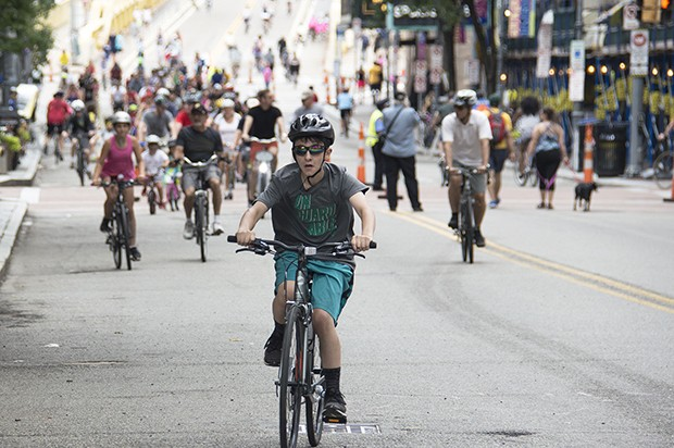Cyclists cross the Roberto Clemente Bridge during OpenStreetsPGH on Sun., June 25. - CP PHOTOS BY JORDAN MILLER