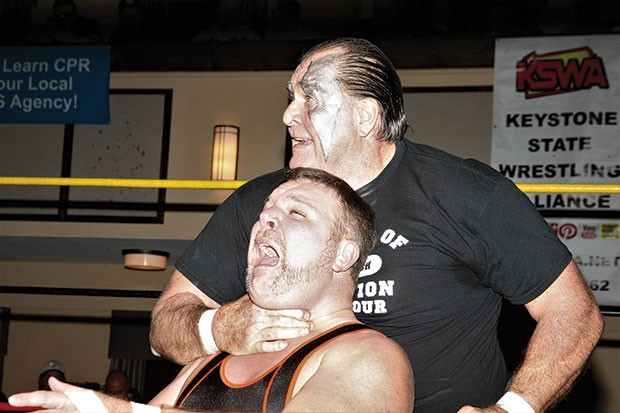 Bill Eadie, who will wrestle his final singles match on July 22, chokes Shawn Blanchard at a 2016 Keystone State Wrestling Alliance event.