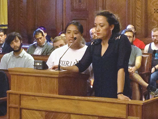 Brenda Solkez (right) translating for an undocumented immigrant speaking at a July 12 public hearing - CP PHOTO BY RYAN DETO