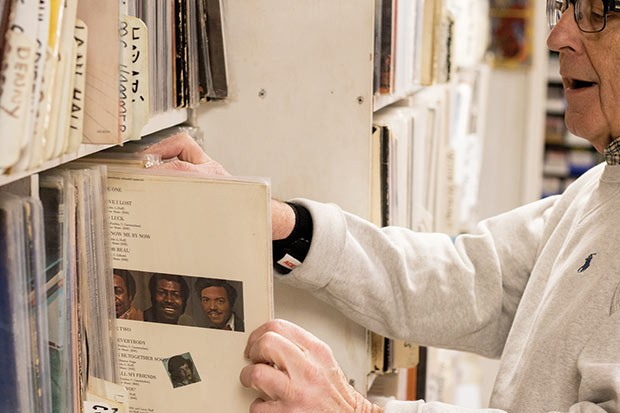 A customer browses records at the Attic Record Store in Millvale - CP PHOTO BY LUKE THOR TRAVIS