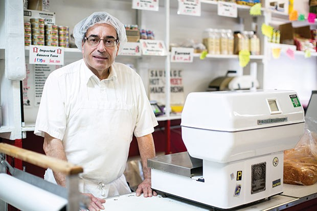 Joseph Grasso behind his counter at Henry Grasso Co., Inc. - CP PHOTO BY JOHN COLOMBO