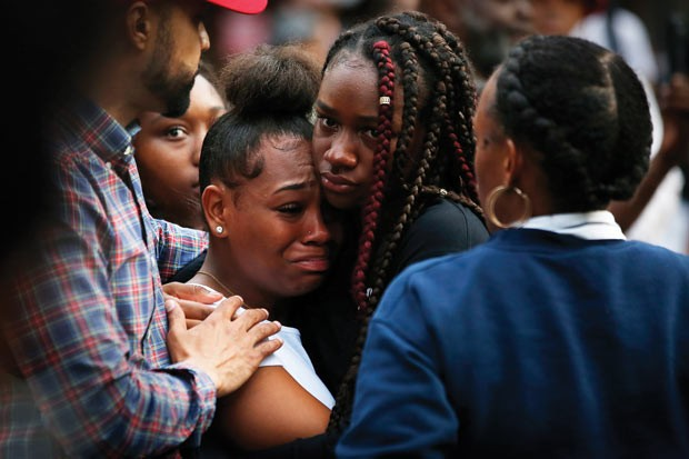 Tia Taylor, a classmate of Antwon Rose Jr., breaks down after speaking at a rally on Friday. - CP PHOTO BY JARED WICKERHAM
