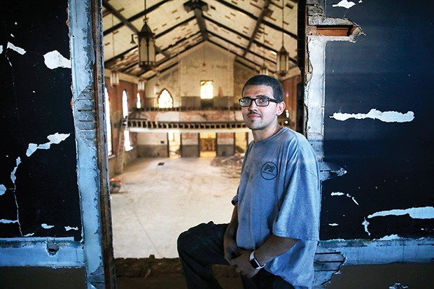 Rich Weber, part of the demo crew for P2 Construction, stands above the second floor at St. Peter's.