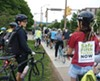 Bike advocates take part in a protest ride to demand safer bike infrastructure in Oakland.