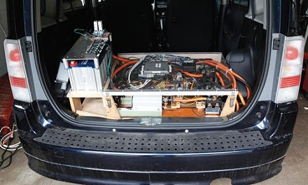 Under the Scion's rear hatch; the raised assembly at left includes the supercapacitor. - HEATHER MULL