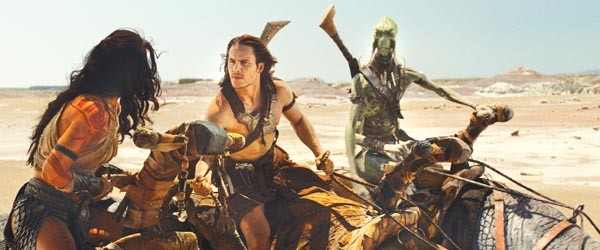 Uneasy rider: John Carter (Taylor Kitsch), flanked by two kinds of Martian