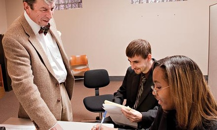 University of Pittsburgh law students Jonathan Payne and Brittney Pepper discuss legal matters with professor Harry Gruener during a recent law clinic. - BRIAK KALDORF