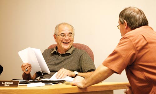 Verona Mayor Leonard Brennan talks with police chief Guy Truby at an Oct. 14 borough council meeting. - HEATHER MULL