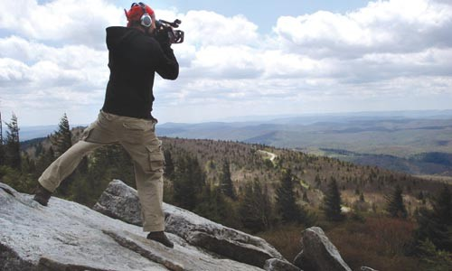 Videographer Tim Weber films from atop West Virginia's Spruce Knob. - PHOTO COURTESY OF DENA GALIE