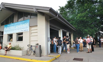Visitors to ChargeCar's July 16 cookout and open house gathered at the Electric Garage, housed in an old Exxon station on Forbes Avenue, near CMU's campus. - HEATHER MULL